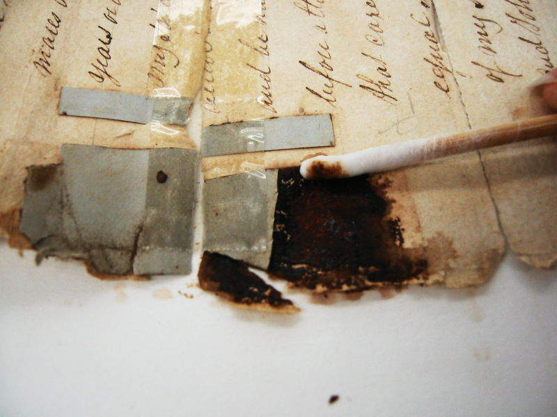Using cotton bud to repair document
