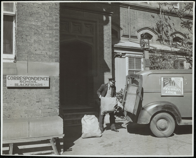 Caption: Correspondence School - Lessons on their way from the State Correspondence School (Blackfriars), Sydney. Everyday P.M.G. mail vans make several journeys from the school with new lessons, and return with work sent in by distant pupils.  Digital ID: 15051_a047_003374.jpg  Date: c. 01/01/1946